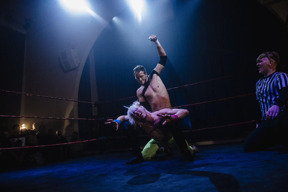 Chris Brookes about to deliver a gruesome wet willy to Chuck Mambo, because wrestling is serious business   (photo: The Head Drop)