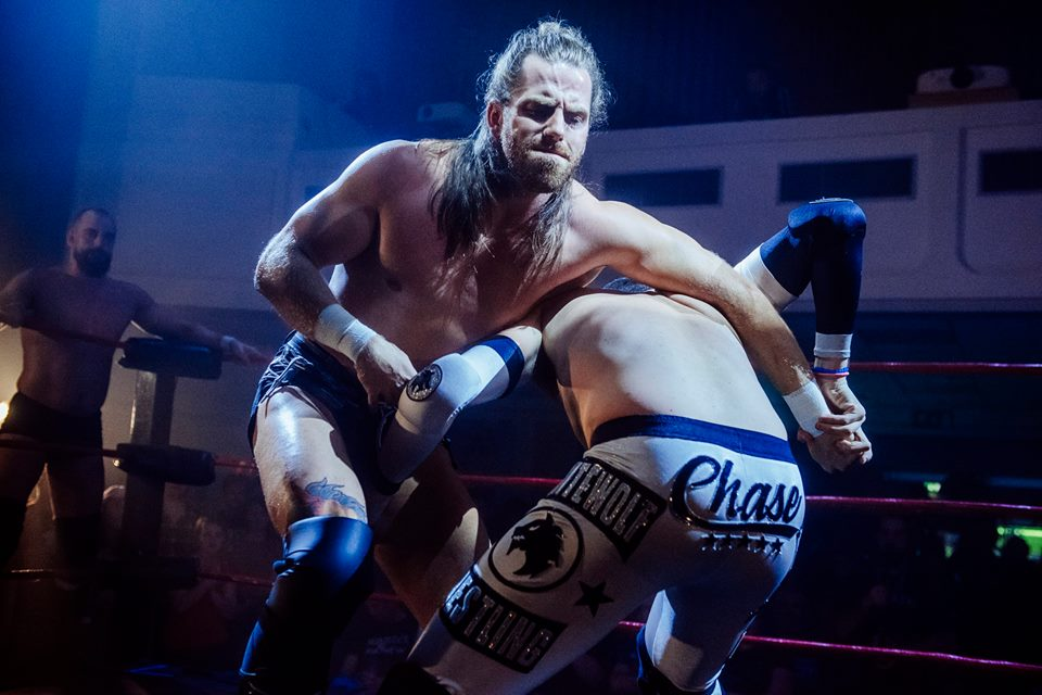 James Drake locks up with Carlos Romo at the RIPTIDE Rumble event (photo: The Head Drop)