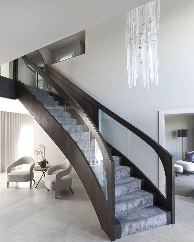 Another view showing off this unbelievable contemporary staircase, looking into TV room.  #interiordesigner #interiorarchitecture #classiccontemporary #contemporaryinteriors #furnituredesign #home #interior123 #homedecorinspo #instahome #luxuryinteriors #interiordesign #leeaustindesign #bespoke #chandelier #interiordesignbelfast #contemporary