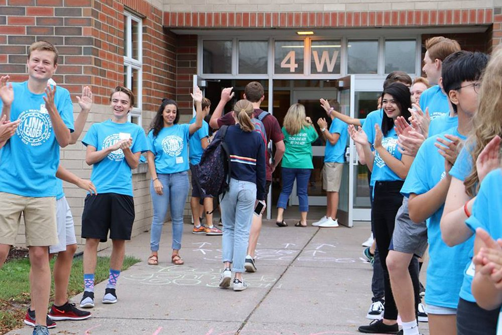 High school mentors, part of the Link Crew, greet new students on the first day of school in 2017.