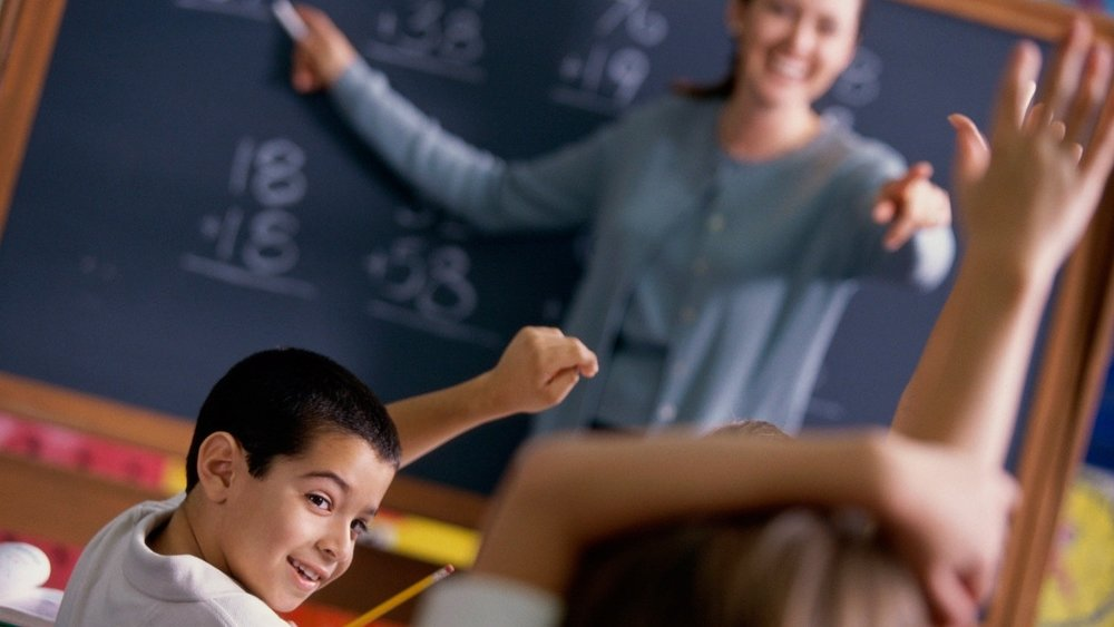students-hands-up-in-classroom%2B%25281%2529.jpg