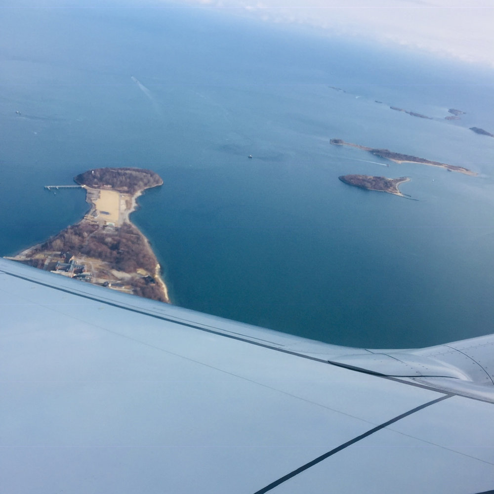 """Flying above the Boston Harbor with """"Ghost in Daylight"""" on the headphones"""