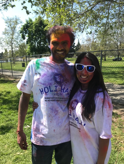 Sheenika and her husband covered in colored powder to celebrate the Indian festival of Holi.