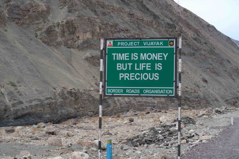 """""""Time is Money, but life is precious"""" - 10 Inspirational Indian Road Signs"""