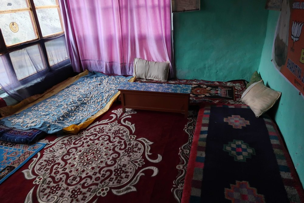 Bedroom with floor mattresses and blanket with drying yak cheese