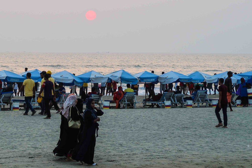 Bangladeshis enjoying the beach at Cox Bazar around sunset