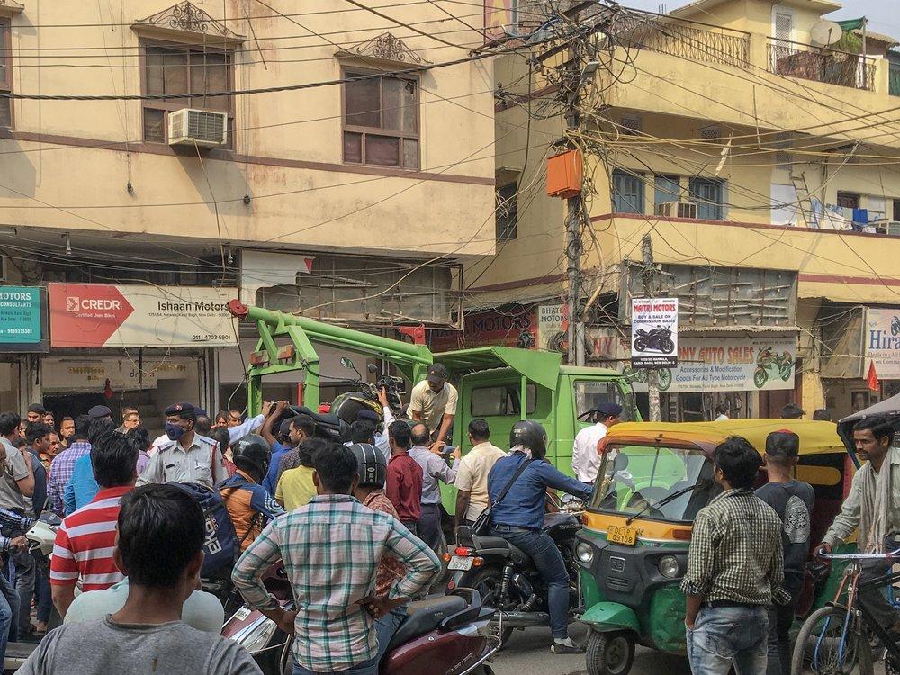 Police seizing motorbikes in Karol Bagh, Delhi