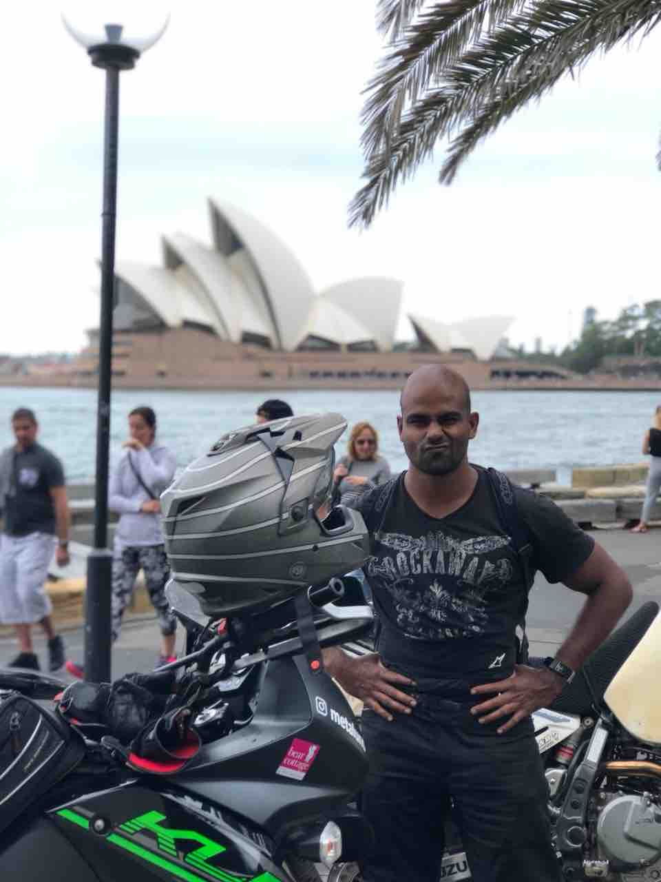 Lincoln with his Kawasaki KLR 650 in Sydney, Australia