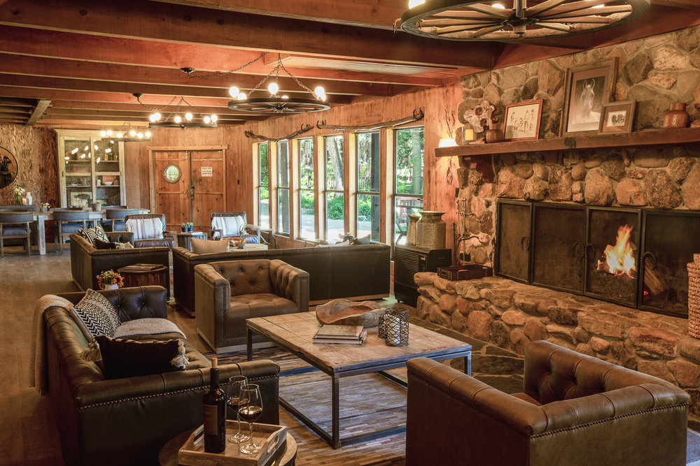 Interior photo of the main fireplace inside the lodge at Greenhorn Ranch