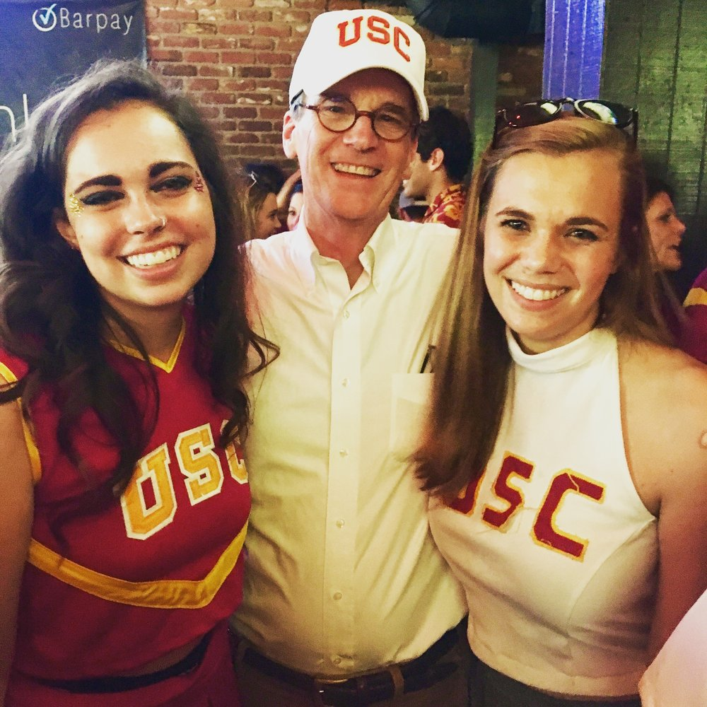Katy's sister (also CIS alumna), her father, and Katy at a USC football game.