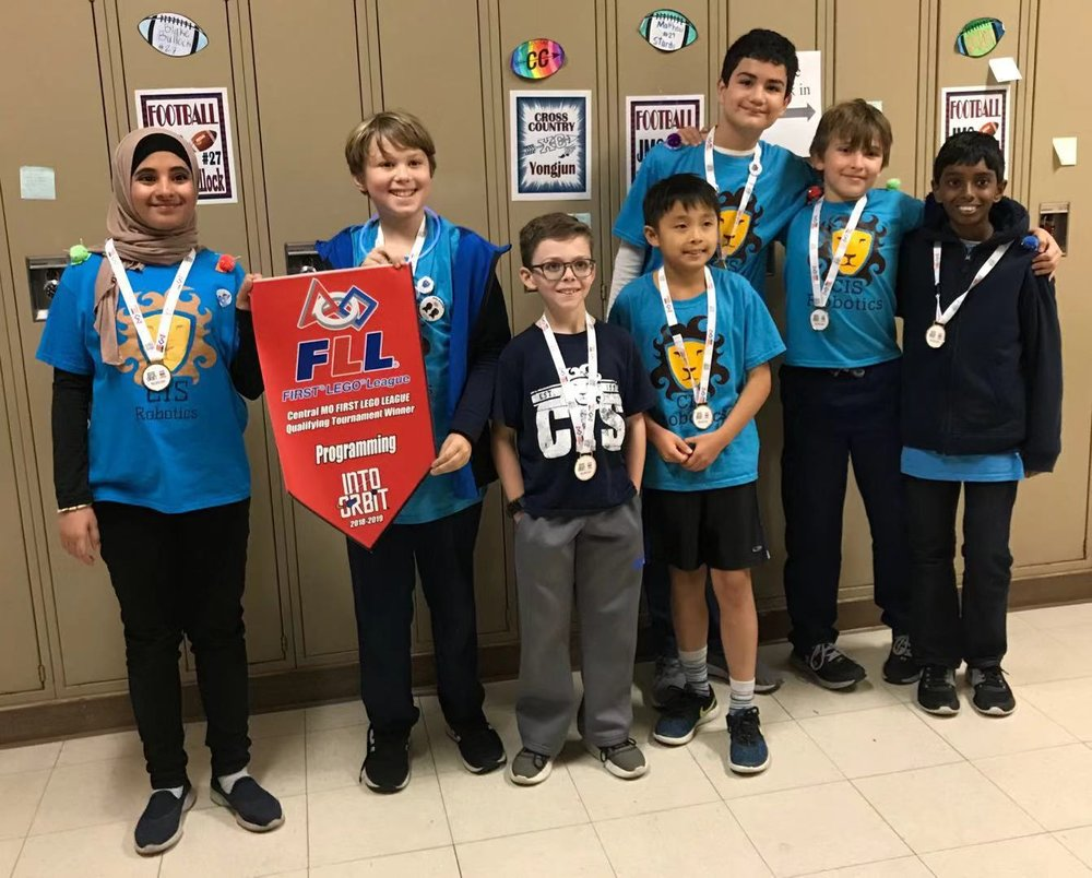 Above: The robotics team shows off the medals they won at the Lego competition!