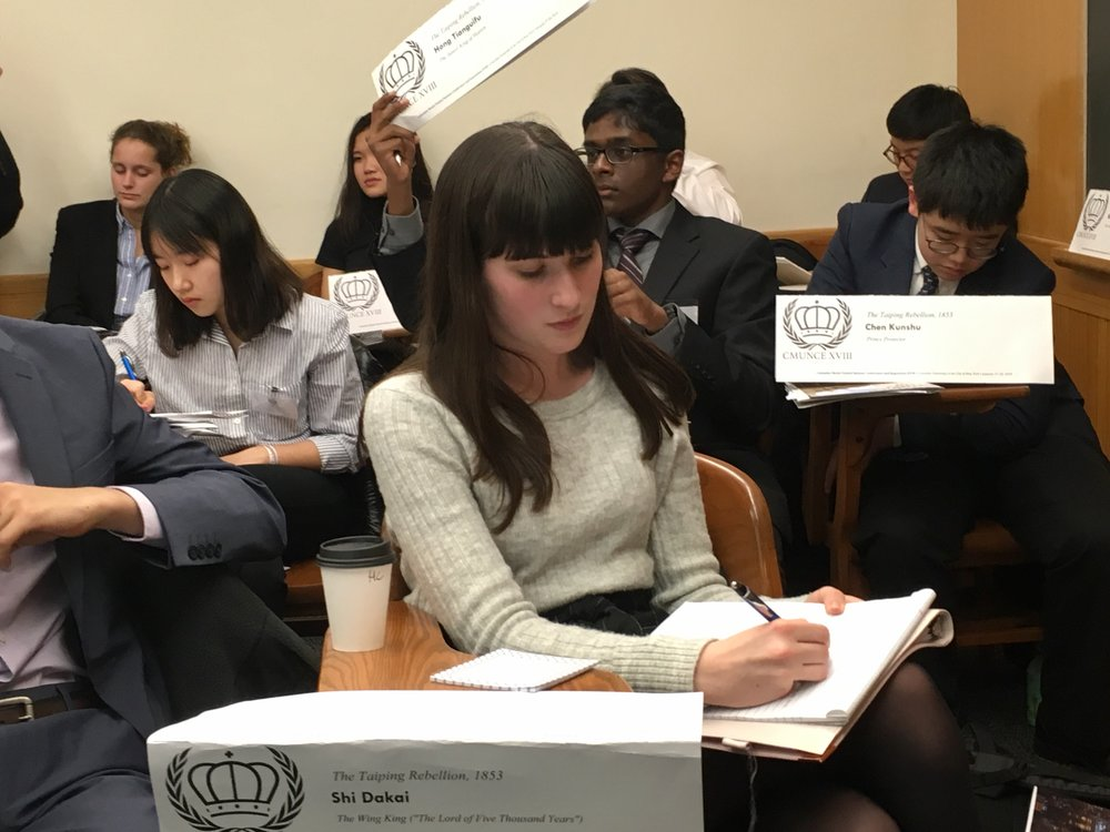 Abigail Reardon composes a crisis note during a moderated caucus on the Taiping Rebellion. Crisis notes are a way to exercise powers outside of traditional debate.