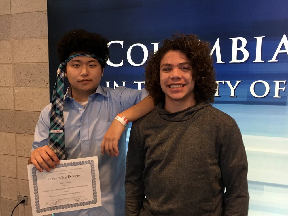 Borui Zhang and Marcus Hauan pose after being recognized for excellent performances in their committees.