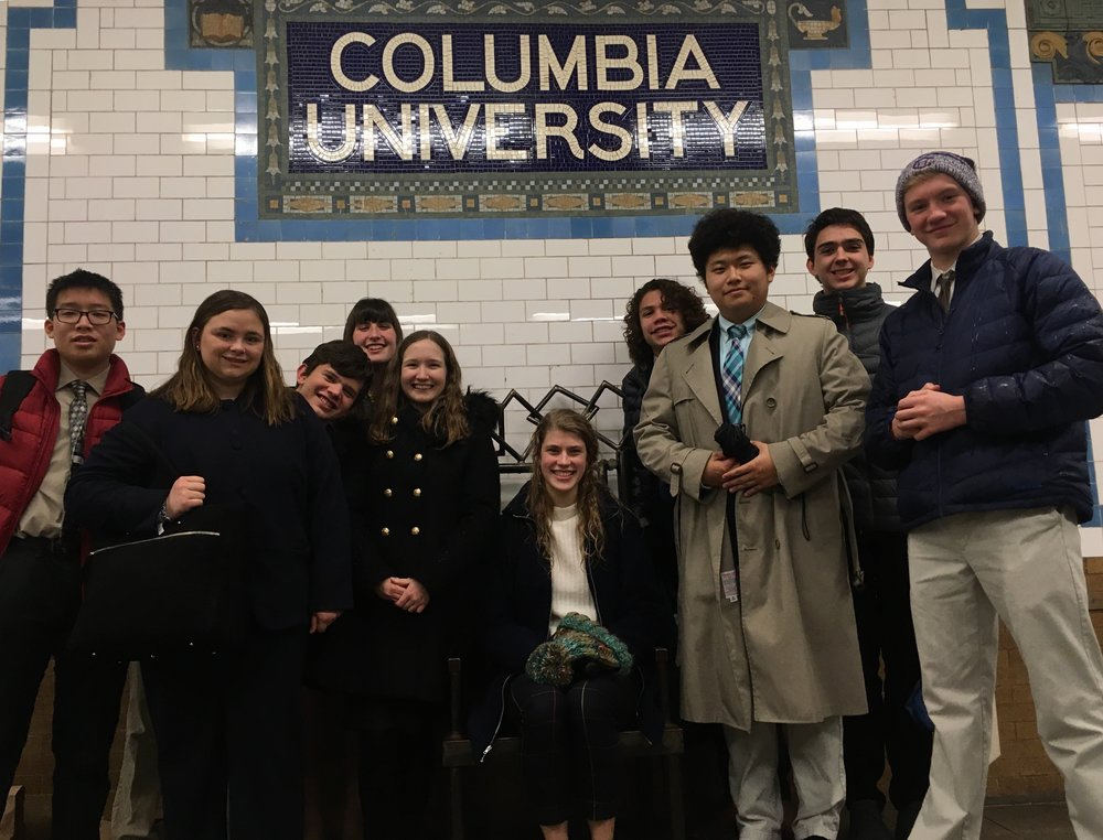 Model UN delegates wait for the train at the Columbia University subway stop. In addition to honing their debate skills, they learned to navigate the NYC public transportation system.