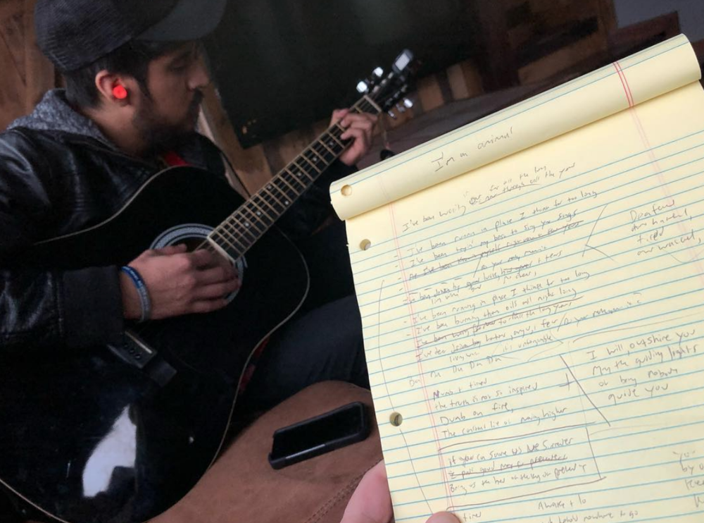 The Weapon plays in the studio as I write down lyrics at the last minute.