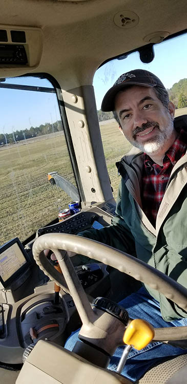 Look ma! I'm driving a HUGE John Deere Tractor!