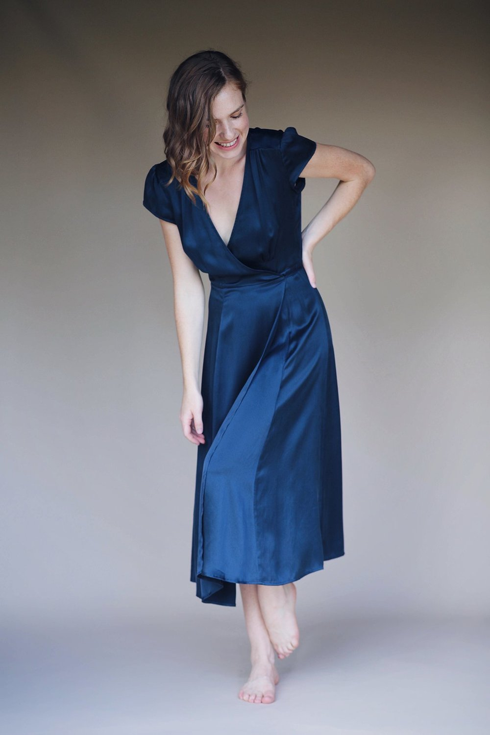 Silk Wrap Dress in Lapis - A classic wrap dress that is timeless, and able to be worn dressed up or dressed down. This is a wrap, midi length dress with a full fabric skirt.100% Silk • Midi length • Bra friendly • Wrap waistband • Full skirt • Short sleeve