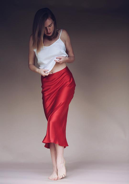 Silk Slip Skirt in Red Roses - This is a 3/4 length skirt with an easy fit.100% Silk • Hidden zipper on side • Sits at natural waist • Bias cut
