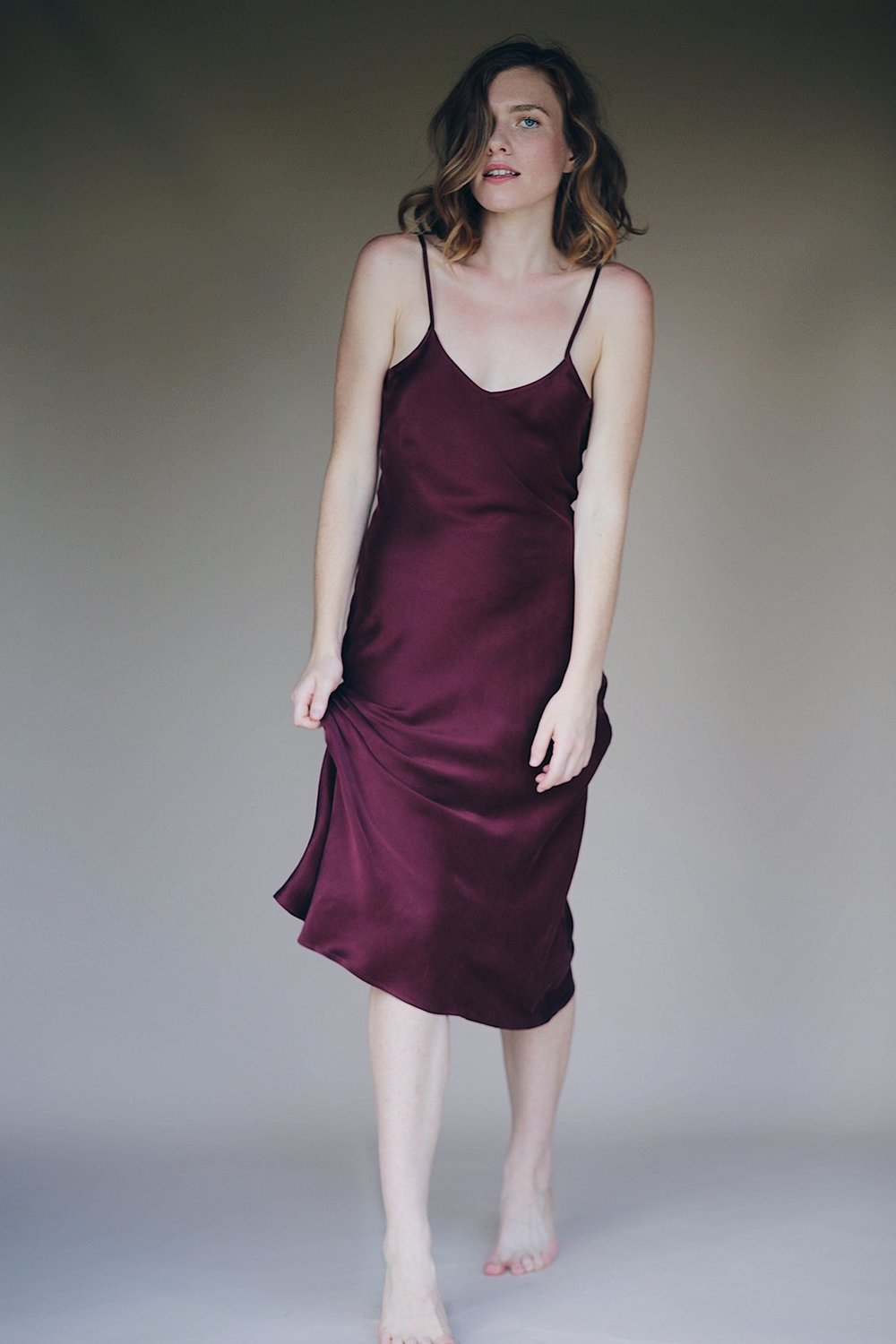 Silk Slip Dress in Bordeaux - You can never have too much of a good thing. This is a midi length dress with an easy fit and a slight v neckline.100% silk • Adjustable straps • Midi length • Slight V Neck • Open upper back • Strapless bra friendly • Bias cut • Easy fit