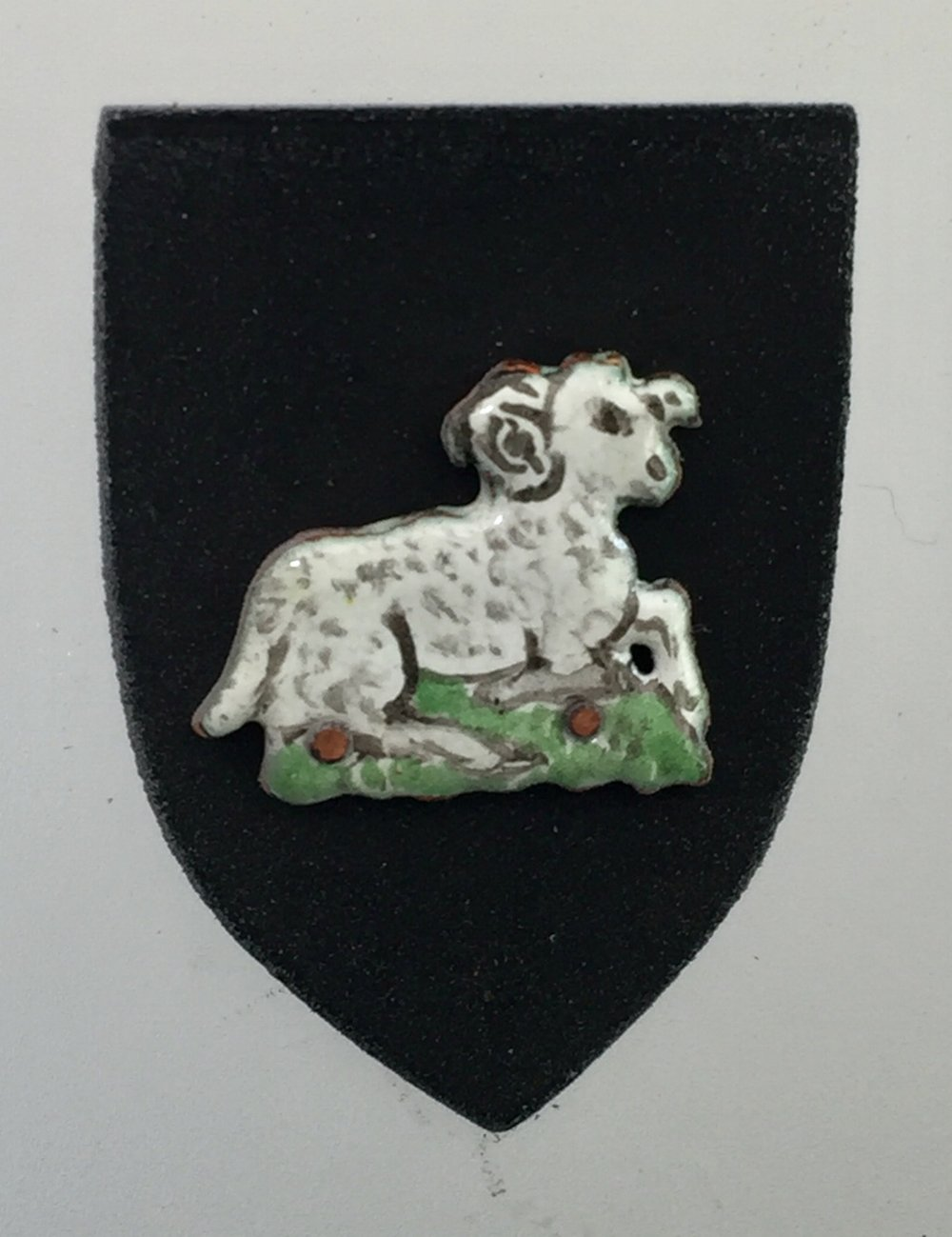 Curly-Horned Sheep on Black Shield
