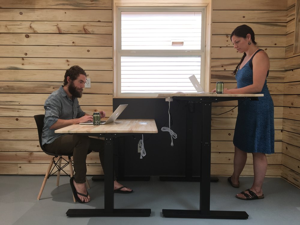 Nester - $300/moUnlimited daysAccess: 24/7Work space: dedicated with automated sit/stand deskMeeting rooms: 4 credits/moCopier/printer: 50p/moAdditional: Highspeed wifi, free espresso and tea