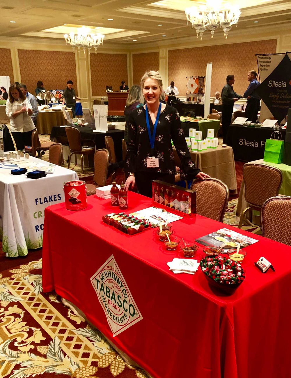 2018-Intermountain-IFT---Caylan-working-Tabasco-booth---Sun-Valley-web.jpg