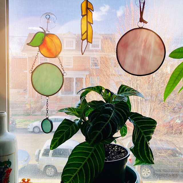 S/o to my bff Anna for sharing the view out of her lovely kitchen window in Denver. The circles are two of my stained glass pieces. A few are for sale at the Lafayette Flea Market, open everyday. (Hi, I'm still here.. living a full life of art, family, rollercoaster emotions, and good coffee while creating stamps and glass things. No big declaration of a social media hiatus.. just haven't felt like posting anything up until now.)