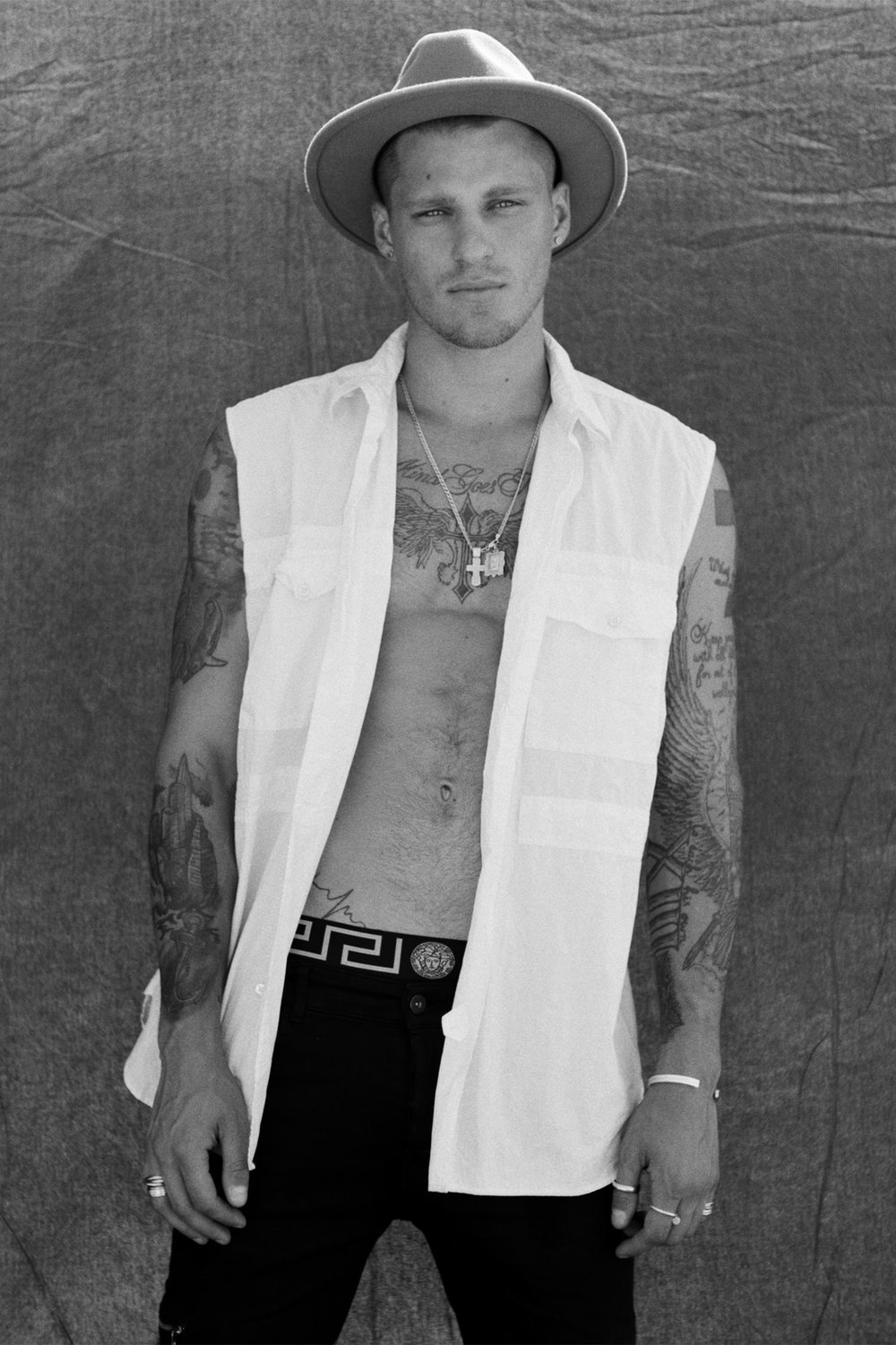 Fashion model Vadim Ivanov shows off tattoos and fit physique in open shirt for black and white photoshoot
