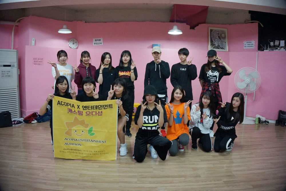 ACOPIA Star Project - ACOPIA Star Project-Dream Team is a trainee system. It is a program where people who aspire to make their debut in the Kpop world apply.This is a program where trainees are given further dance and vocal training by instructors who teach Kpop idols and Korean language by the Korean teachers in ACOPIA School. The program also includes special classes for style and modeling.Aside from this, trainees are exposed by busking in Seoul's hotspots.