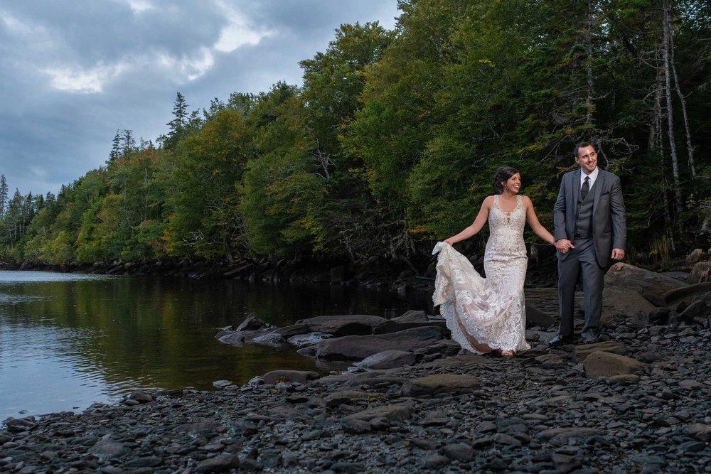 liscombe-couple-walking-shoreline.jpg