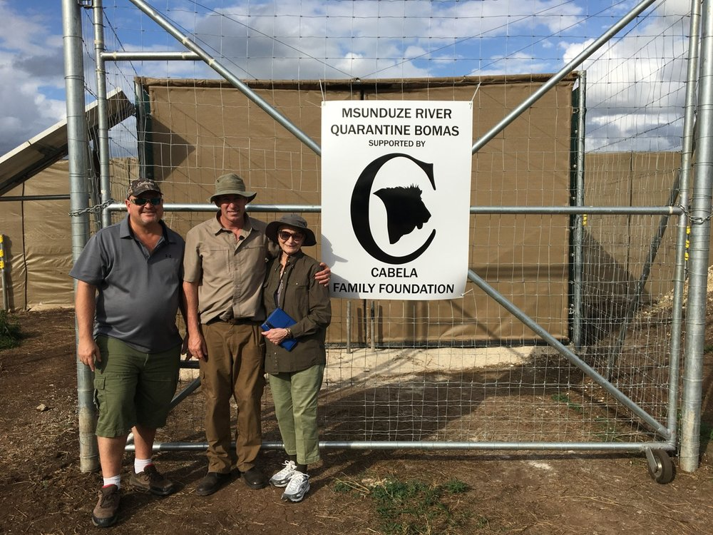 Ivan Carter with Dan and Mary Cabela at the quarantine bomas in South Africa.
