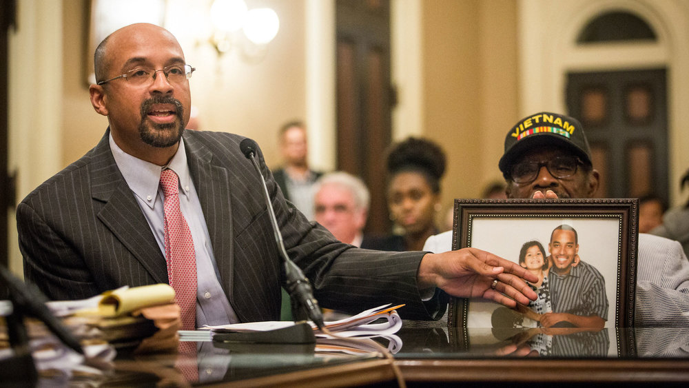 Jacque Wilson, left, and his father, Mack Wilson, right, testify about their brother and son Neko Wilson, during a California Assembly Public Safety Committee hearing at the State Capitol in Sacramento in June. Photo by  Max Whittaker