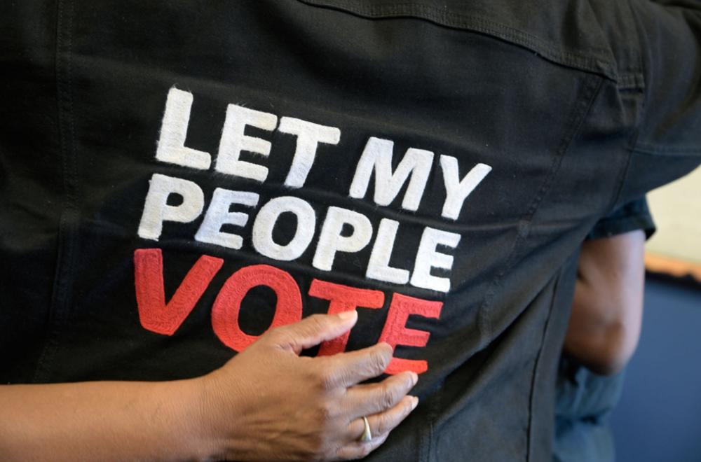 Suffrage activist Desmond Meade is hugged by a friend inside the Orange County Supervisor of Elections office after registering to vote. People with felony convictions regained their voting rights in Florida on January 8, 2019.    PHELAN M. EBENHACK FOR THE WASHINGTON POST VIA GETTY IMAGES