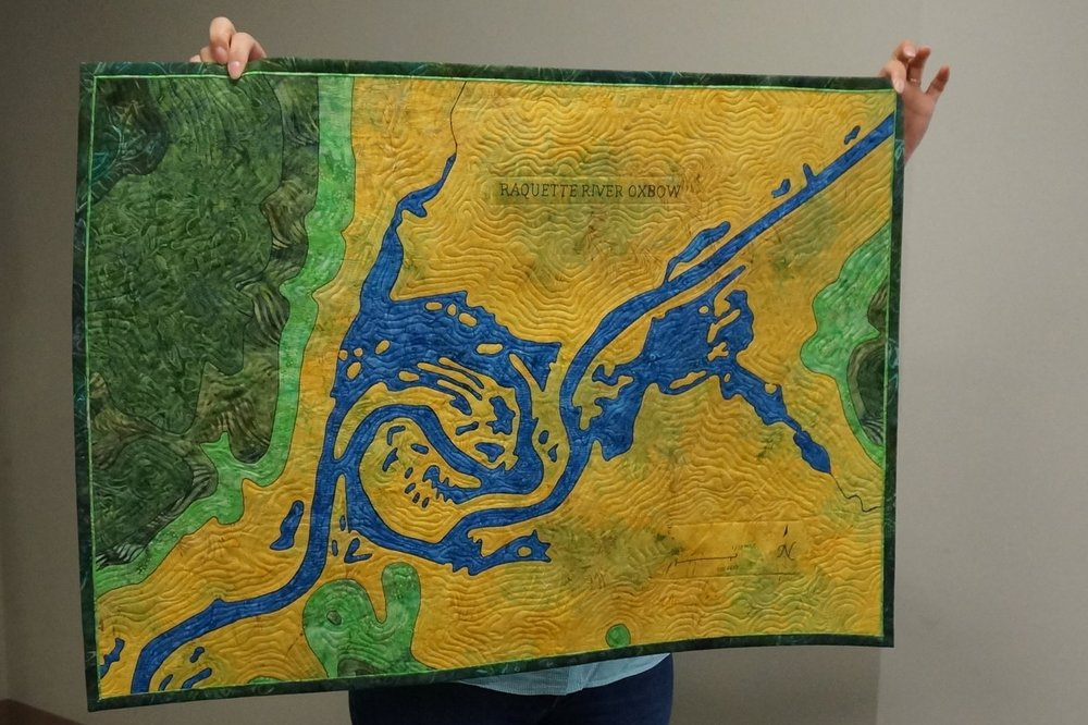 - Tina recently made a map quilt based on a guild workshop with Timna Tarr. It's a map of the oxbow in the Raquette River in upstate New York.