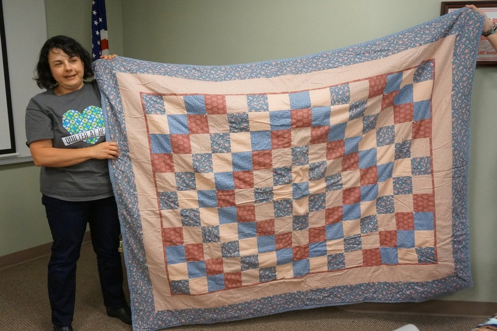 - Chrissy chose an Eleanor Burns pattern for her first quilt, which she made to fix up her first apartment in 1996.