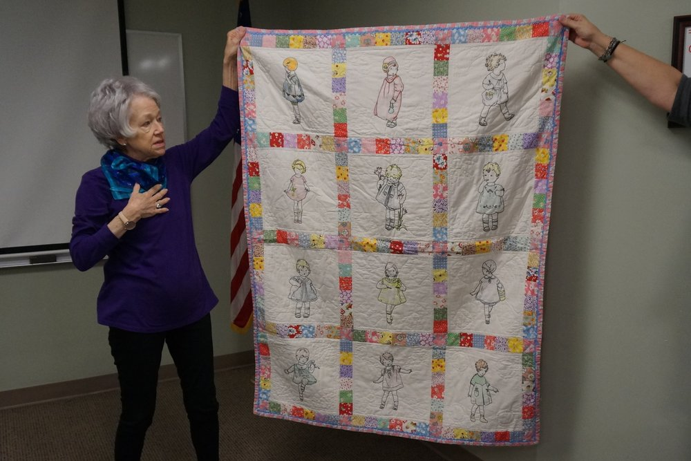 - Suellen's first quilt was a Georgia Bonesteel dresden plate quilt, which she gave away. The later quilt shown above was made for her granddaughter.