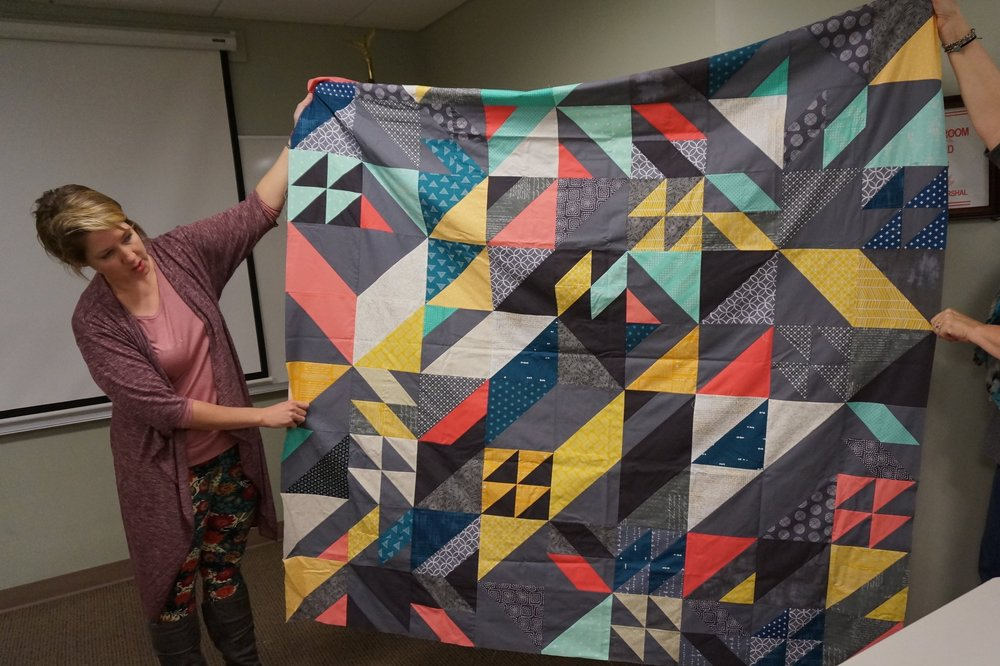 "- Christine finished the top for her latest quilt-in-progress at the recent RIMQG retreat. It's the ""Rebel Quilt"" by Libs Elliot, and Christine was even more of a rebel because she pieced the blocks in a different order!"