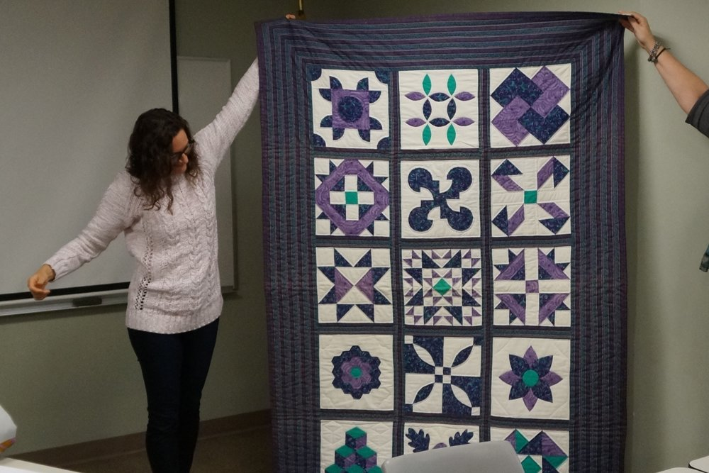- Leslie's first quilt was made of wool and hangs in her parents' house. Her second quilt, above, was a sampler pieced and quilted almost entirely by hand during a class.