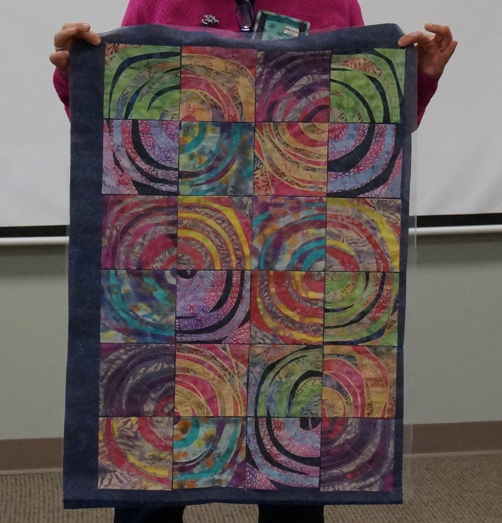 "Denise put together a top from the blocks she made in Sue Ahnrud's ""Swirls of Scraps"" workshop."