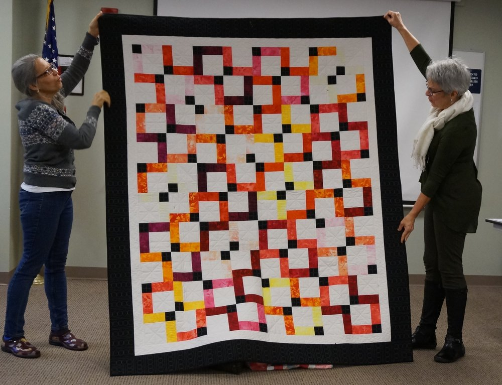 Celine also finished her split nine patch quilt.