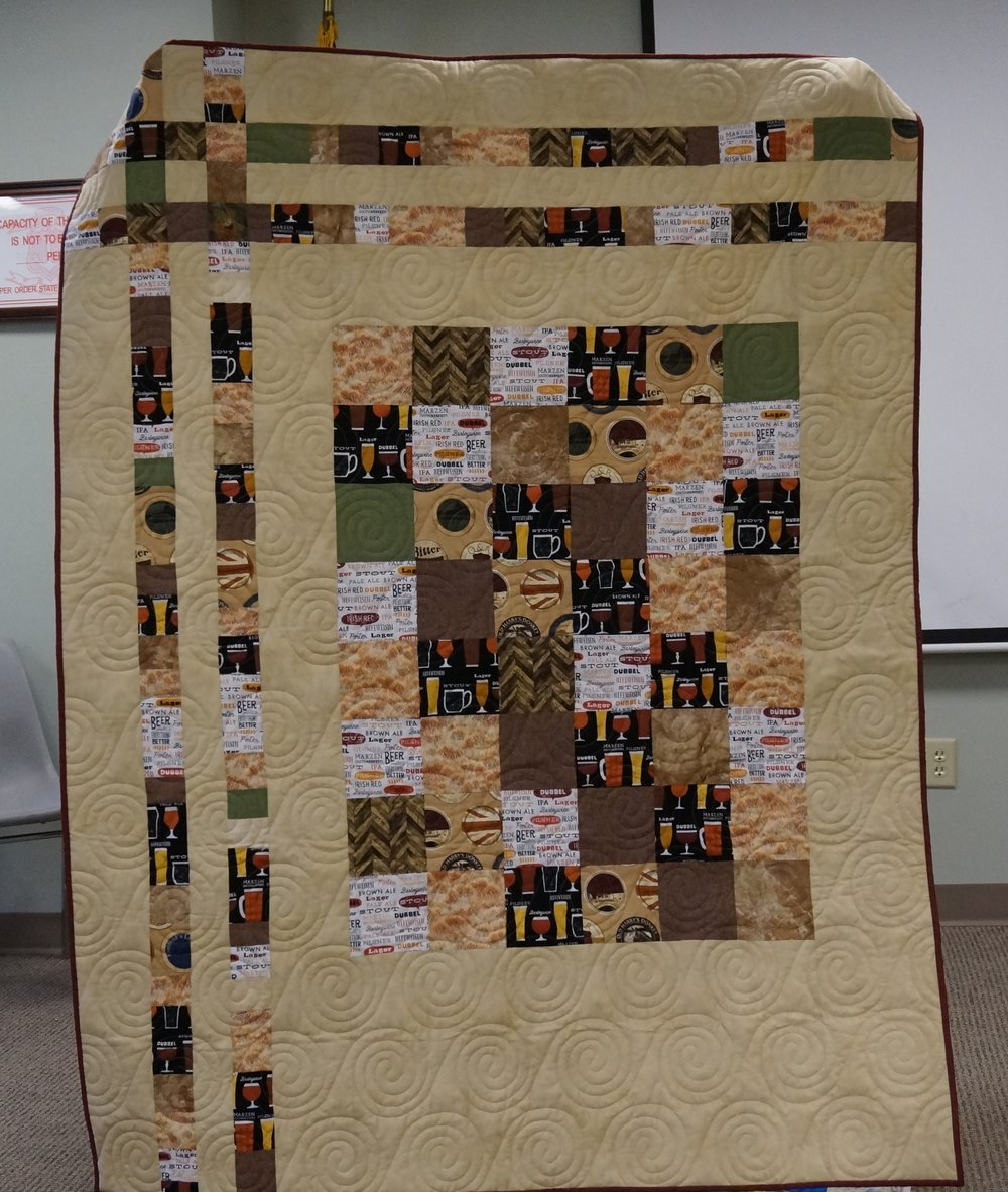 Nicole made this quilt for a friend who is a brew master.