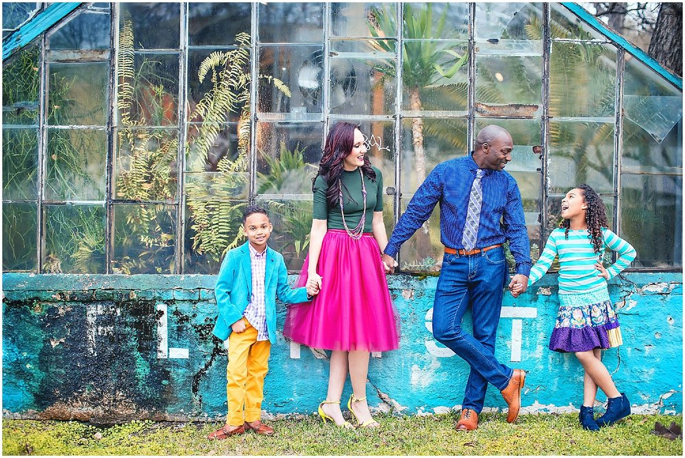 Family portrait in colorful clothing by The Woodlands Photographer spryART photography.