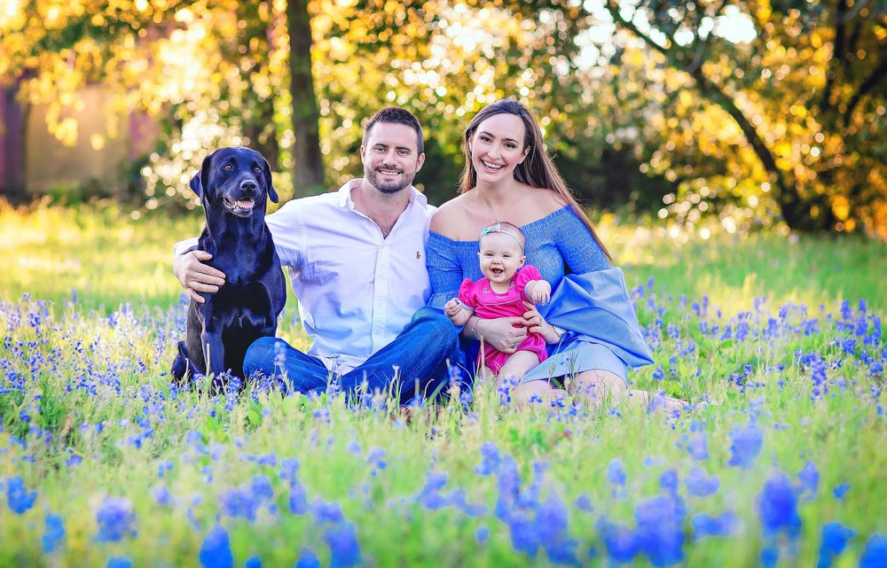 Vibrant and colorful family portrait in the bluebonnets in The Woodlands, Texas by spryART photography.