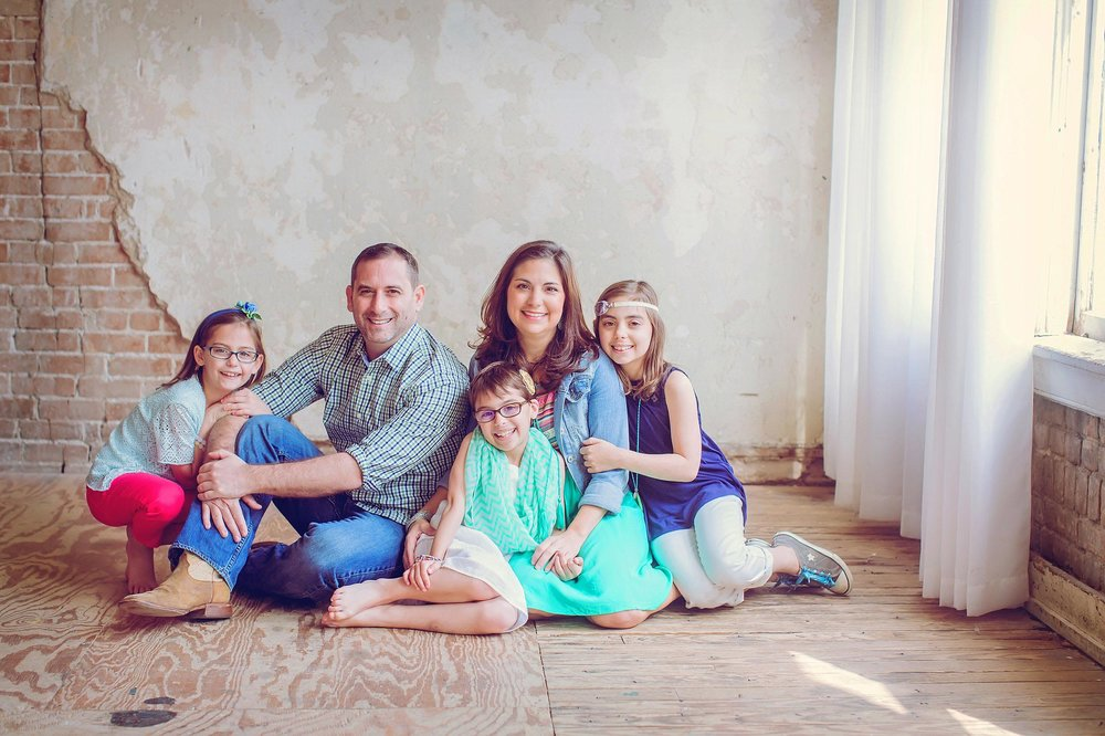 Indoor, rustic studio family portrait in Houston by spryART photography