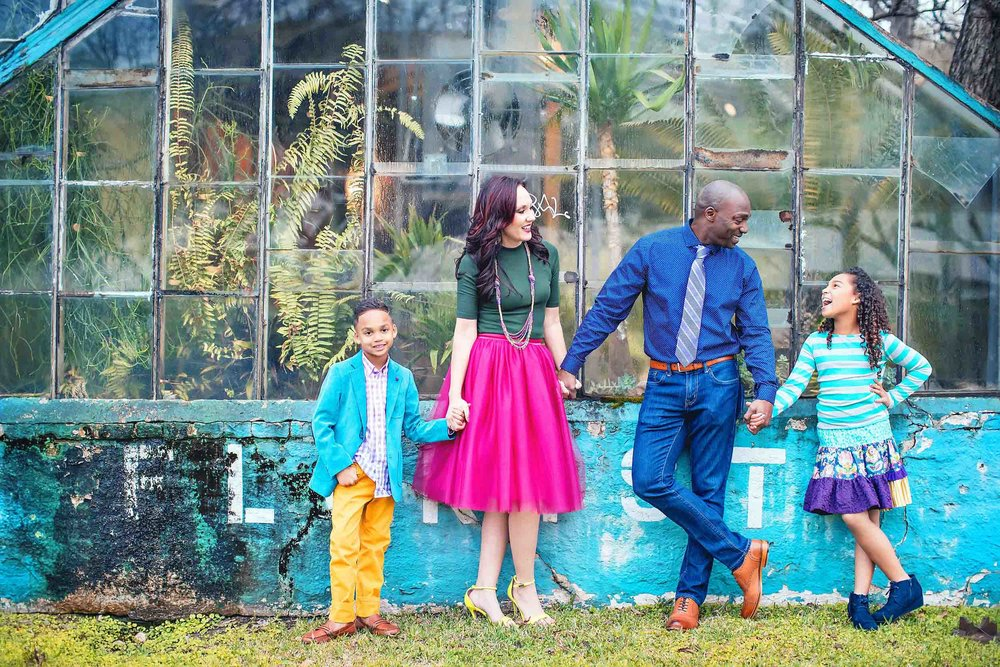 Family dressed in trendy and colorful clothes for family portraits.