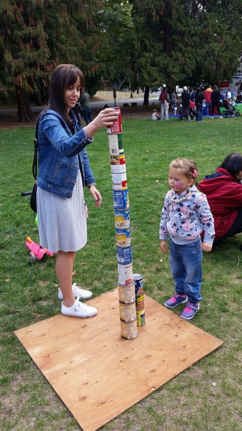 Building a skyscraper with cans of food collected at Mt. Baker Day at the Park