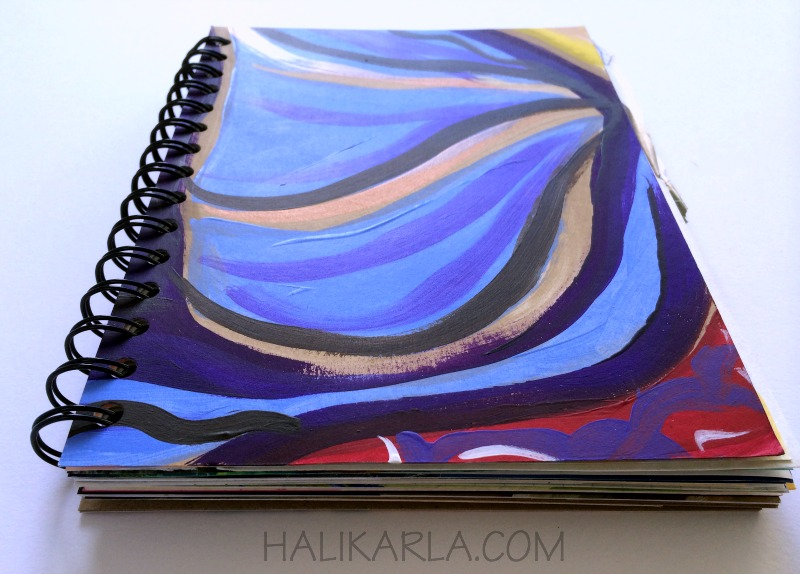 handmade art journal bound with upcycled and recycled papers and art, Hali Karla