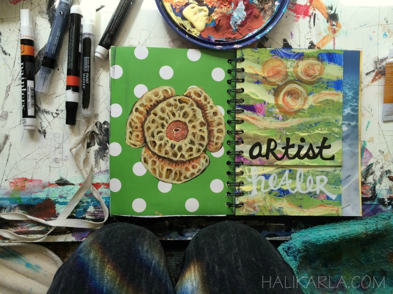 art journal page in process, altered book made of scraps and old paintings and old office supplies, bound at home