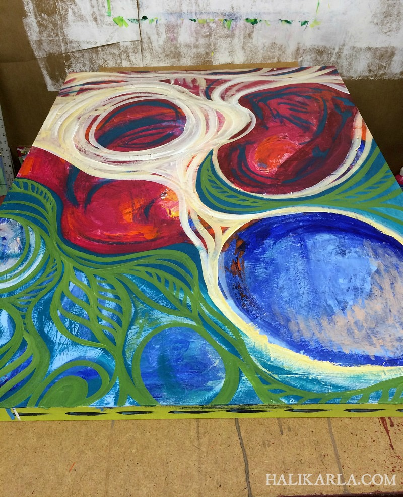painting in process on the table, early stages, Hali Karla Arts