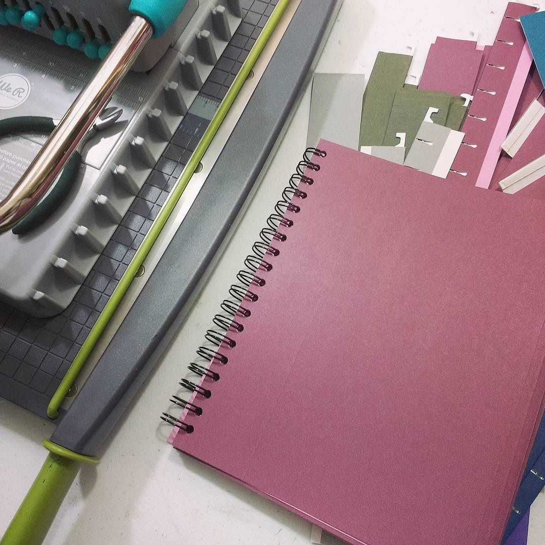 making homemade art journals with re-purposed office supplies in the studio (Hali Karla Arts)
